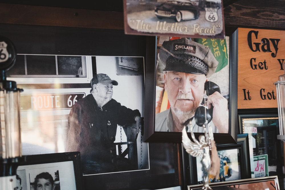 Portraits of Gary Turner hanging in his office.
