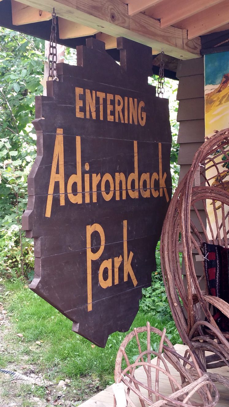Classic Adirondack Park welcome sign, displayed at a vintage goods shop