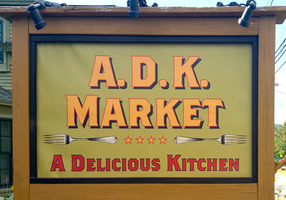 "ADK Market. ""Our food is so good, you'll need two forks."""