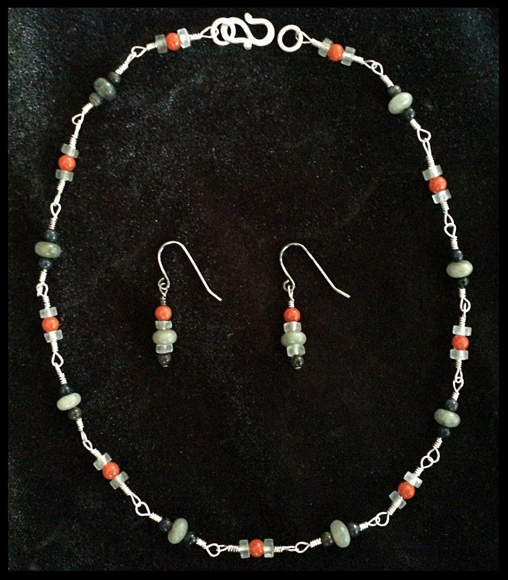 Abundance necklace: coral, labradorite, petrified wood, silver