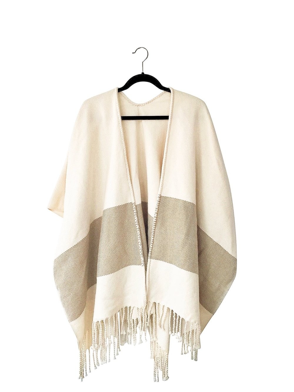 TRIGO PONCHO - Simplicity and sophistication collide when you wear the Trigo poncho.  A perfect poncho for cool spring days or breezy summer nights.
