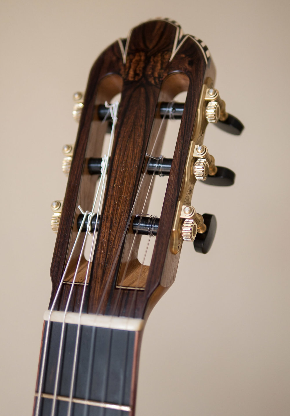 Bookmatched Brazilian Head Veneer.  Maple/Ebony inlays with Bloodwood keystone