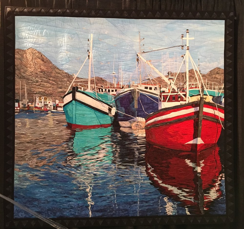 "Quilt ""Reflections of Capetown"" by Cynthia England -- This is a quilt, not a photograph. She has created a reflective image with colored fabric.  It's simply awe-inspiring!"