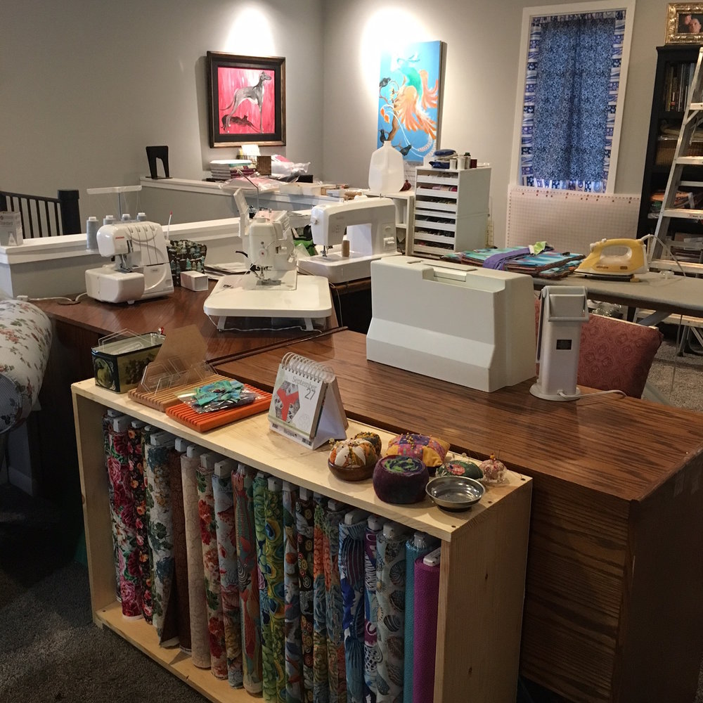 The sewing table (L to R: Serger, Janome 6600p, Sashiko, Embroidery)