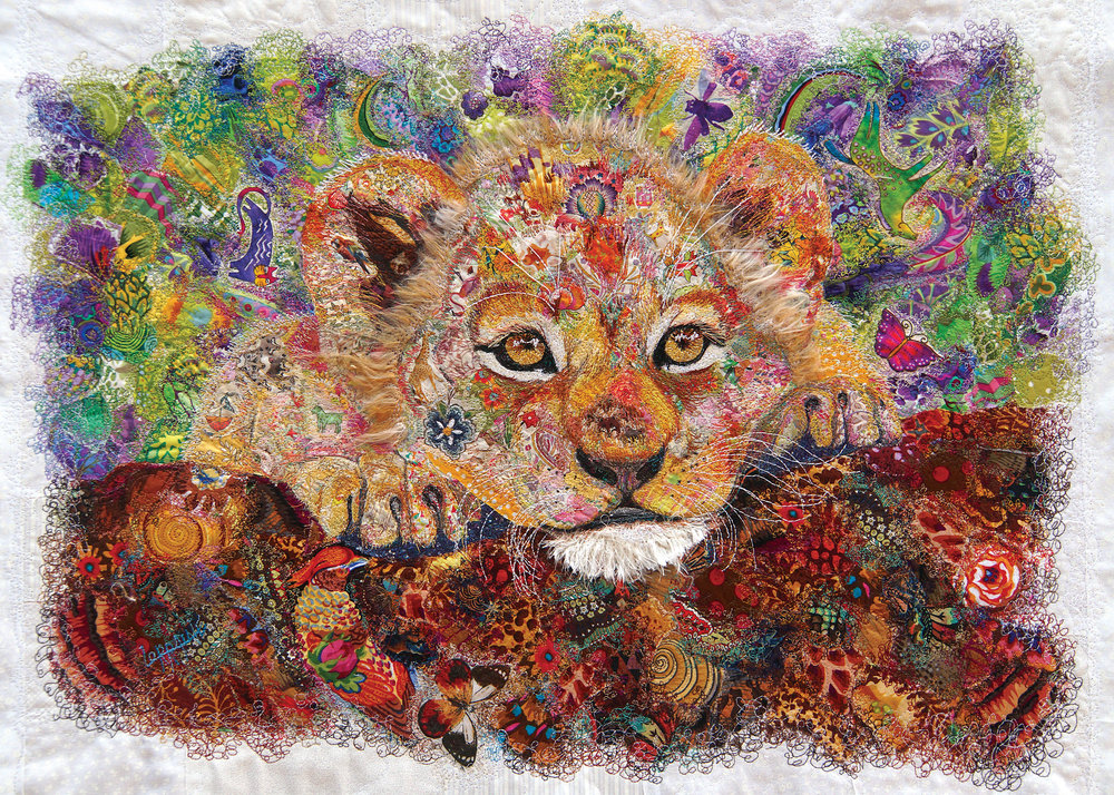 A Prince's Haven   I began working with a lion sanctuary in South Africa. Lions are highly sought after by trophy hunters, and their numbers are dwindling. I was fortunate enough to visit and communicate directly with the lions that live within this protected preserve. I believe they are Master Teachers and are here to help mankind. During meditation communications, they encouraged me to use my art to help the entire animal kingdom, and to think of my hands as an expression of this kindred spirit relationship. We must be lion hearted when we face the uncertainties along our journey. The lions continue to communicate through meditations and this cub appeared in July 2018 with a message regarding protection. If we accept our role as guardians of this planet than we must begin to see the importance of working together to assure ALL of life will continue to survive. I sensed his need to explore yet his uncertainty regarding his future. His eyes held mine and I could feel this future King looking at me with hope. This art will benefit whitelions.org the sanctuary where I first met these magnificent cats.  Techniques: raw appliqué, free-motion embroidery, felting  Materials: Tussah silk, merino wool, banana silk, cotton Original art. Reference photo purchased from Shutterstock