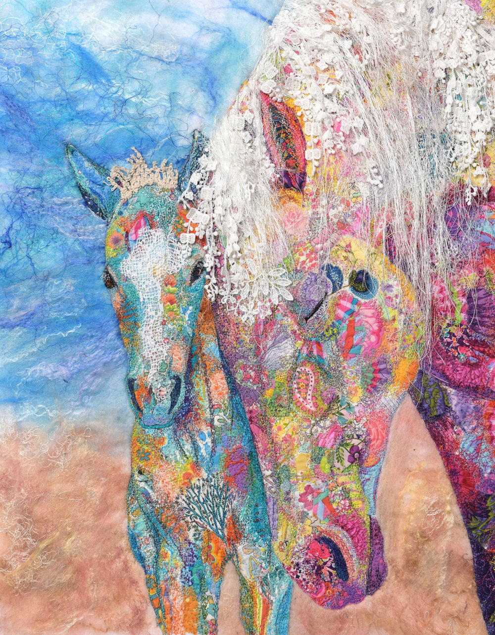 "Adoration   Inspired by meditation I was shown and felt the deep connection of ""motherhood,"" and protection it embodies. This precious bond perpetuates survival, yet does not guarantee it. Mountain lions, storms and fights within the herd are a constant threat. I used delicate fibers such as banana fibers and lace to symbolize the uncertainty that awaits this colt. Tree motifs were incorporated to represent their strong family roots.  Techniques: Machine embellished, wet-felted, free-motion embroidery, raw appliqué, thread painting Materials: Cotton, lace, Merino wool, tussah silk, banana fibers, vintage doilies Original art. Photo reference with permission by Kent Keller"