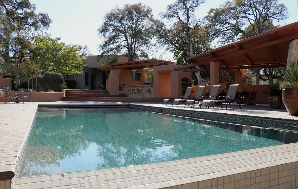 Patio and BBQ Area End of Pool View 2 E.jpg