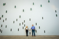 engagement couple in front of Austin Art museum