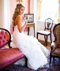 Bride on a red chair at Neill-Cochran House