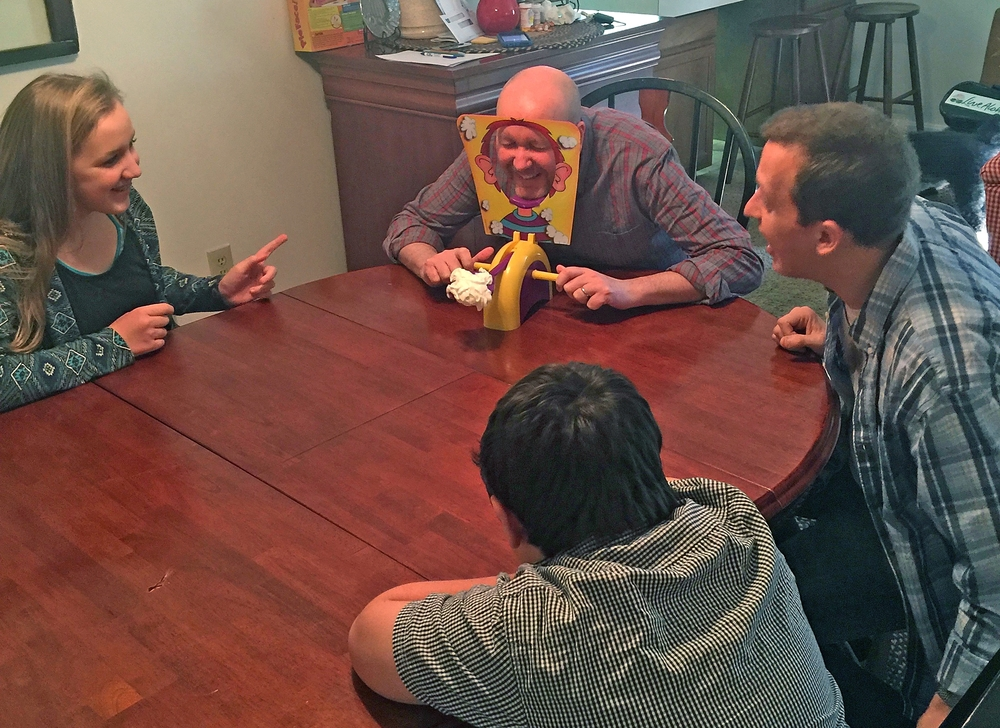 Playing the Pie Face game with our nephew, Bryson