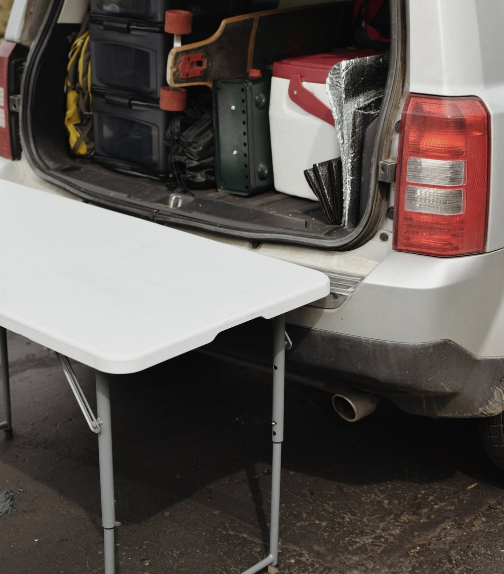 Table - Wanting a cooking space no matter where I was, I searched around for a folding table that fit perfectly to the height of the back of my Jeep.