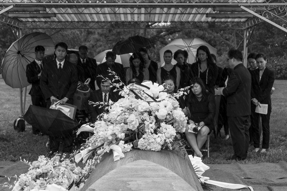 Family and friends of Chinsoo Kim, who died on 9/14/17 after a yearlong battle with lung cancer, attends the burial service at Pinelawn Cemetery in Farmingdale, NY. Left to right: Kevin Kim, Justin Kim, Anthony Kim, Suksoo Kim, Scott Glenn, Nancy Kim, Janice Kim, Sonya Pretzel, Miwha Kim, Keunuma Kim, Morgan Kim, Sally Kim, Anne Yarnal, Pastor John Choi, Nancy Hunte. September 19, 2017. Photo by Sung Cho.