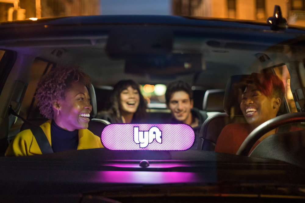 Ride-sharing service Lyft invites customers to sit up front. The Brand Relationship shifts from driver/passenger to friend/friend. -