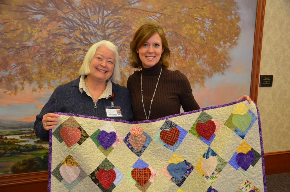 Quiltmaker Donna Ludeman (left) with Catawba Regional Hospice counselor Elizabeth Arditti.