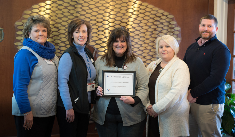 Catawba Regional Hospice's We Honor Veterans team displays Level 4 certification: (L-R) Debbie Ball, Director of Clinical Services; Kelly Tate, VP of Community Outreach; Caron Tucker, VP of Clinical Outreach; Abby Young, Business Services Specialist; and Scott Lofland, Operations Project Manager.