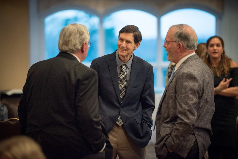 Dr. Will Thompson (center) greets Dave Clarke, CRH President/CEO (left), and Board member Dr. Bill Long