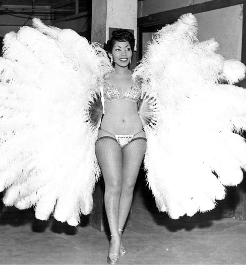 "Jean Idelle, burlesque fan dancer. In her prime,  Jean Idelle  was billed as the ""Sepia Sally Rand"". She performed with gorgeous grand ostrich fans. Sepia is a shade of reddish brown, and decades ago was also used as an alluring alternative description to black or Negro/Negress."