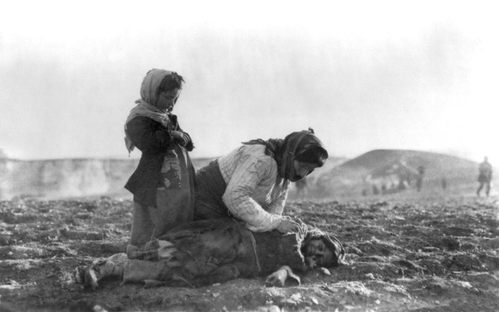 Armenian mother kneeling beside her dead child