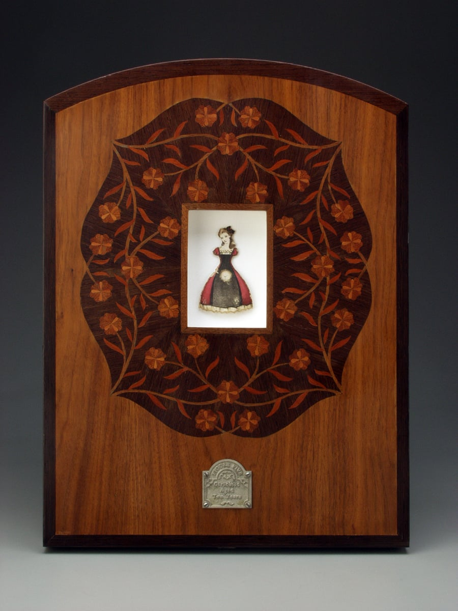 "Figure Five.- Girlchild Aged Ten Years.  1998-1999. 20.5"" h x 15"" w x 2"" d. Lithography, Acrylic, Marquetry, Walnut, Wenge, Fabric, Magnesium, Glass."