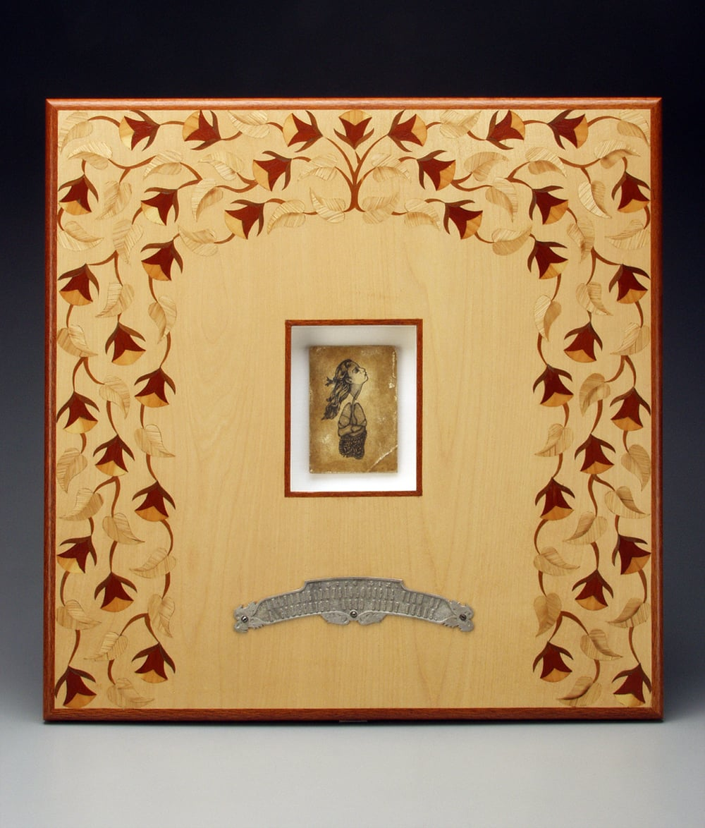 "Figure Six.- Anatomicophysiological View of a Girlchild, Aged Eight Years.  1996-1999. 22.5"" h x 22.5"" w x 1.5"" d. Letterpress, Acrylic, Marquetry, Lacewood, Maple, Fabric, Magnesium, Glass."