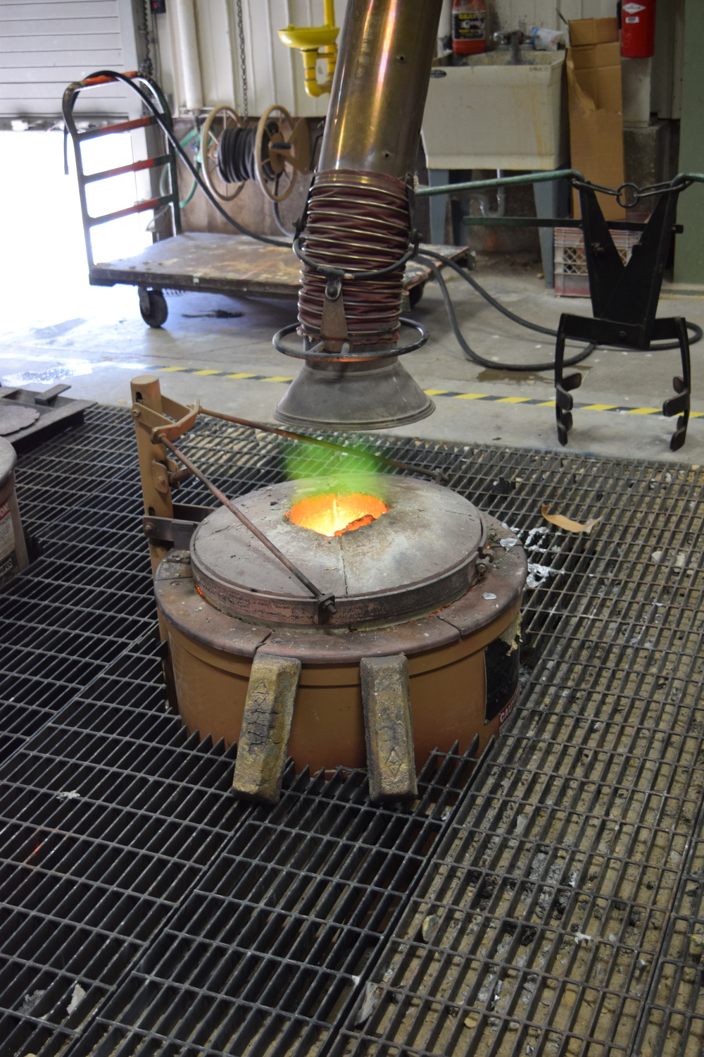 The forge heating up with bronze ingots.
