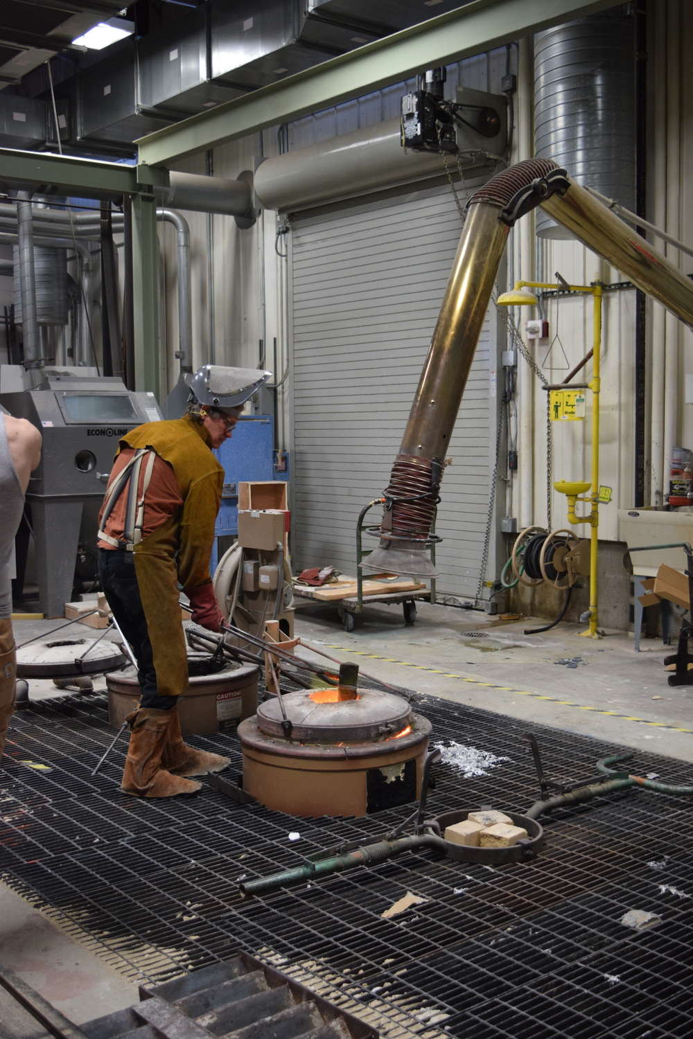 Sculptor and Art Metals instructor Peter Flanary loading the forge with bronze. Take a look at his work  HERE .