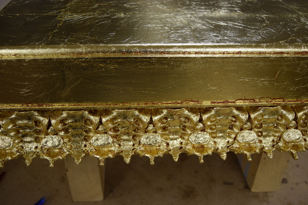 Detail of the gilded base and ornament.