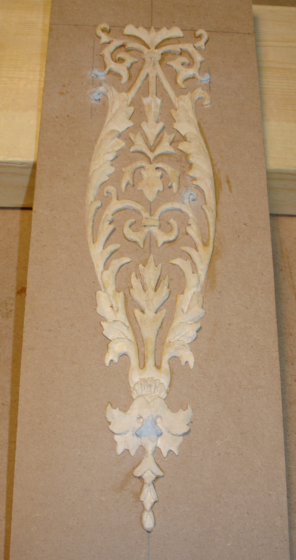 A Basswood carving for the front lower panels.