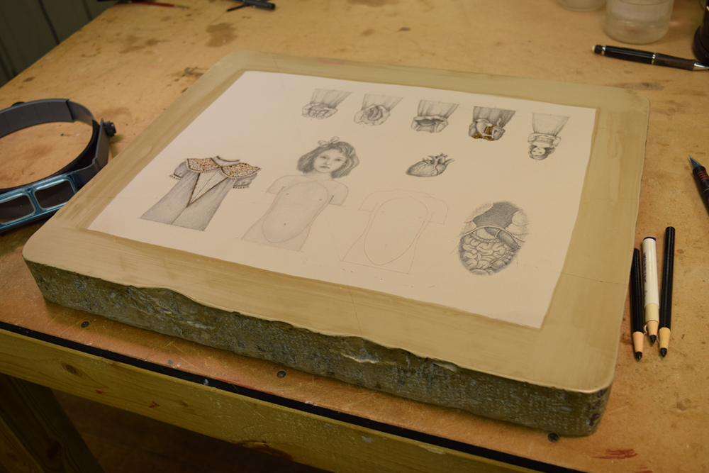 The lithography stone with finished drawings for two upcoming automata,  The Four Humors  and  Cardiomegaly .