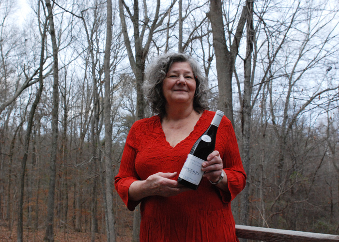 Dr. Sharon Griffitts on her back deck in Florence, Alabama, holding a bottle of Henry Natter Sancerre Rouge 2012. She talks to P&V Radio about feminism, changes in medicine over the past 40 years and gruesome ER tales.
