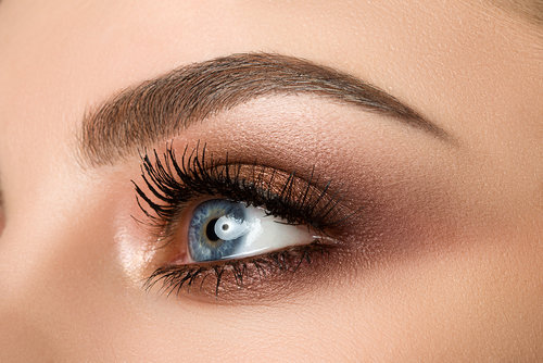 Copy of Close-up of woman eye with beautiful brown smokey eyes makeup