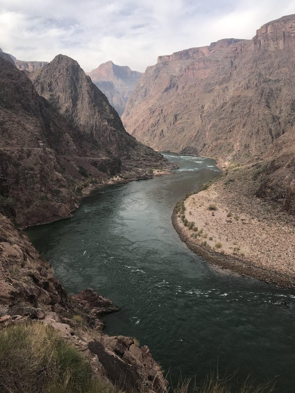 The mighty Colorado River flowing through the Grand Canyon