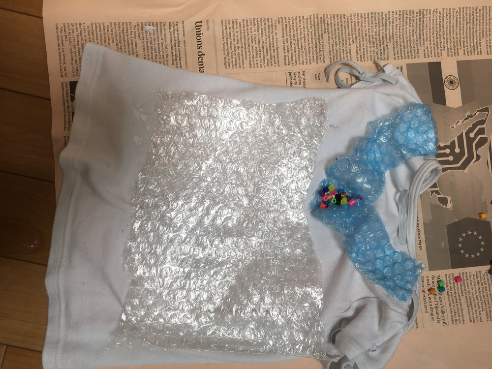 An old T-Shirt decorated with bubble wrap and beads...