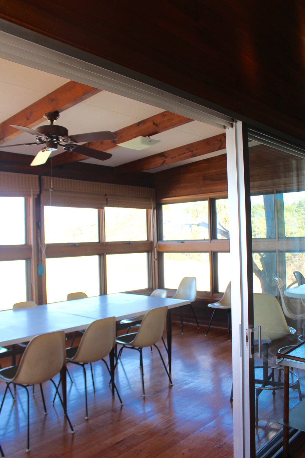 Porch dining room for entertaining large groups of relatives, friends and business associates.