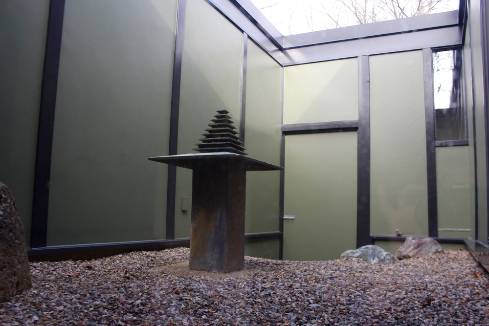 GLASS SLIDERS FROM THE LIVING ROOM LEAD TO A QUIET INNER COURTYARD FOR MEDITATION AND CONTEMPLATION