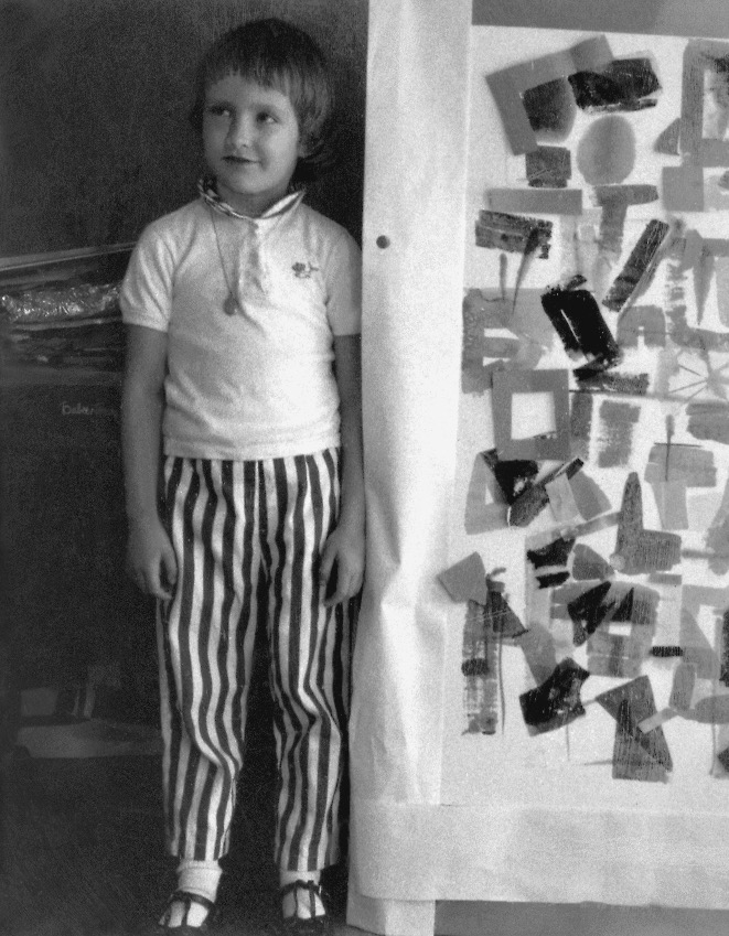Daughter Laurel Firant, at a young age, next to Gerda's painting.