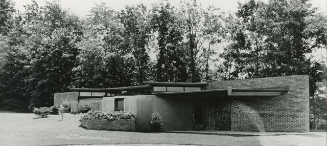 Thornapple River House shown shortly after completion.  Notice the brick wall that runs through the center of the house providing a strong horizontal orientation.