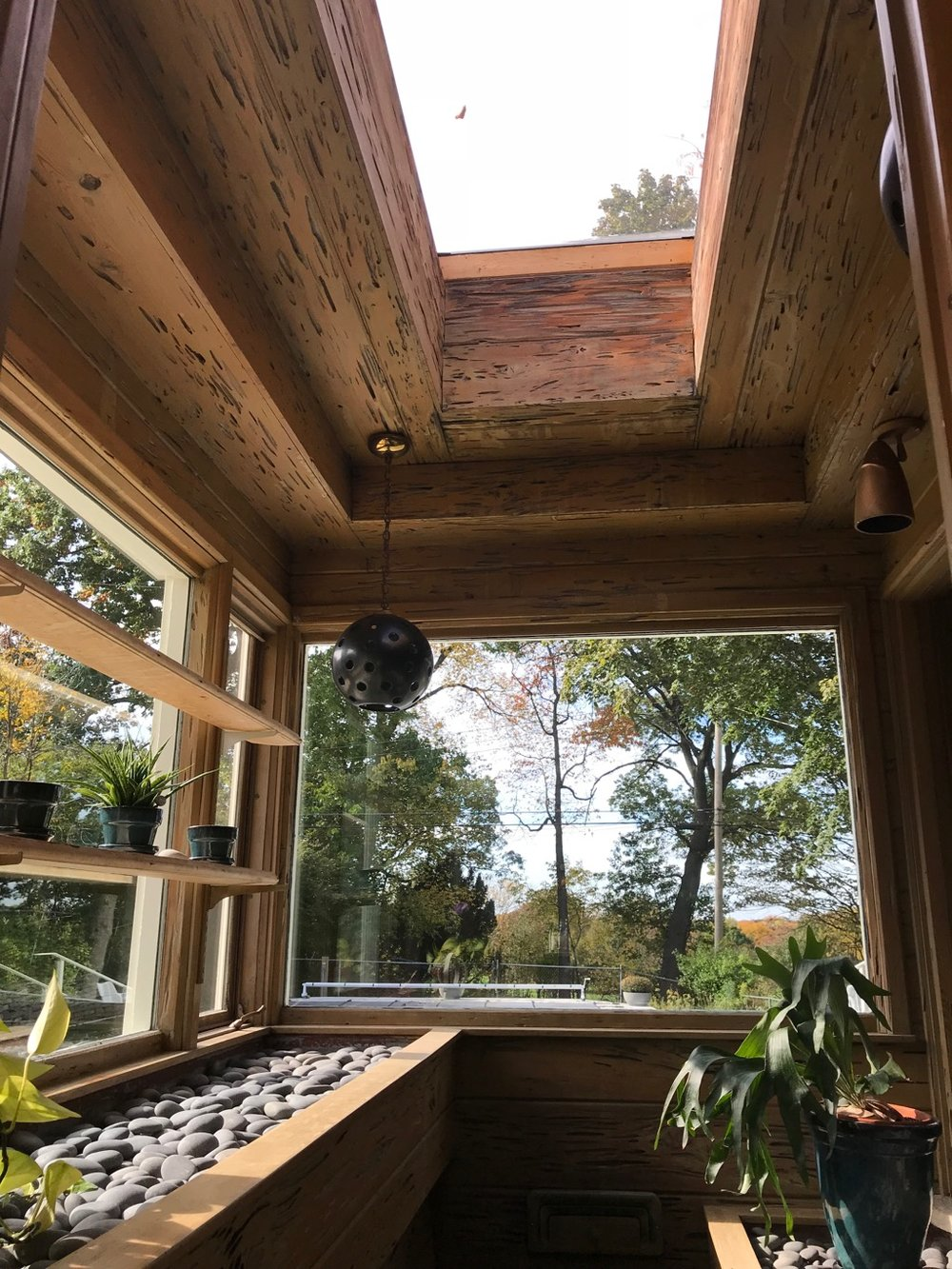 GREENHOUSE WITH PECKY CYPRESS CEILING AND SKYLIGHT