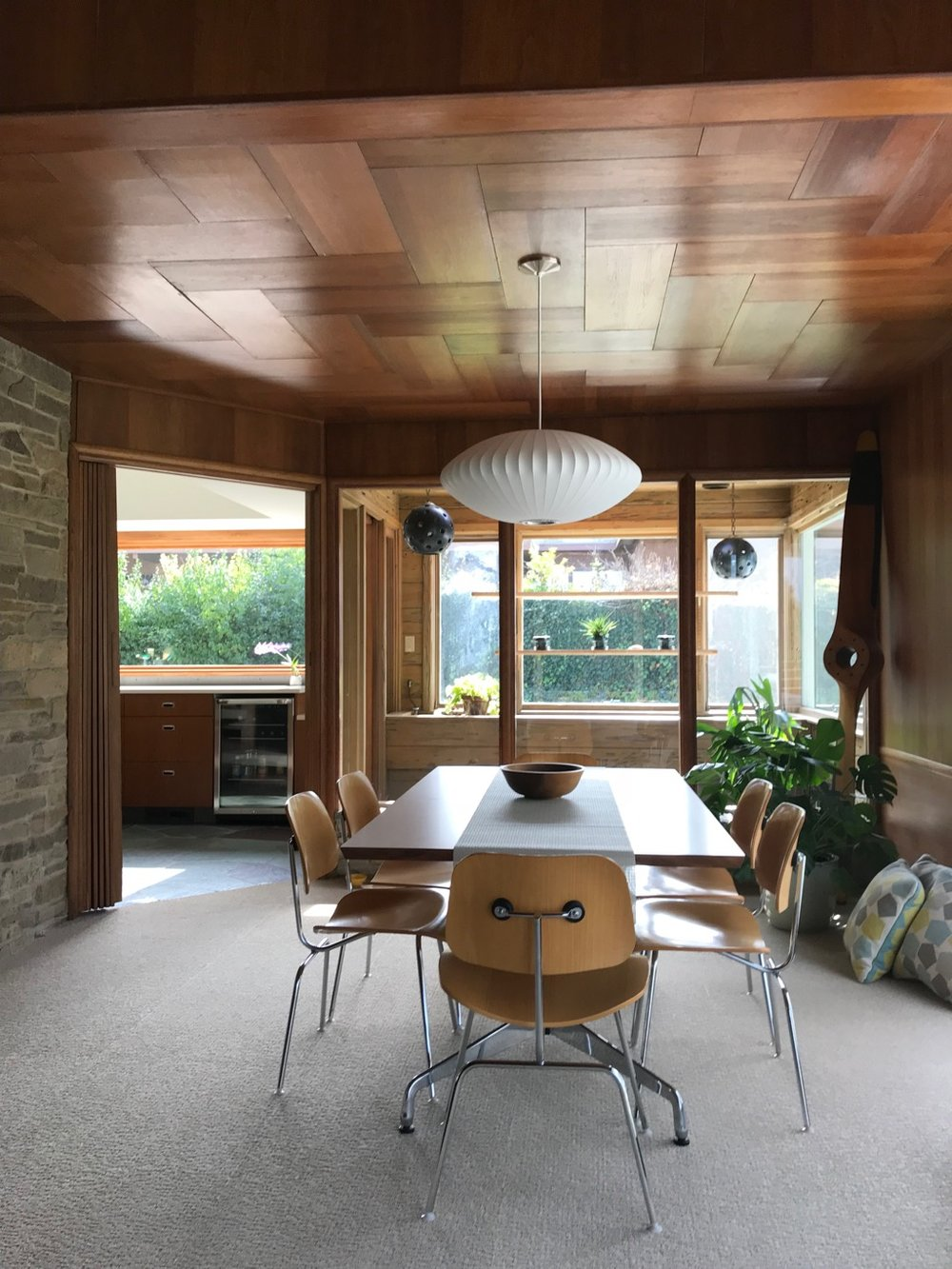 Note the wood ceiling with a herringbone pattern.