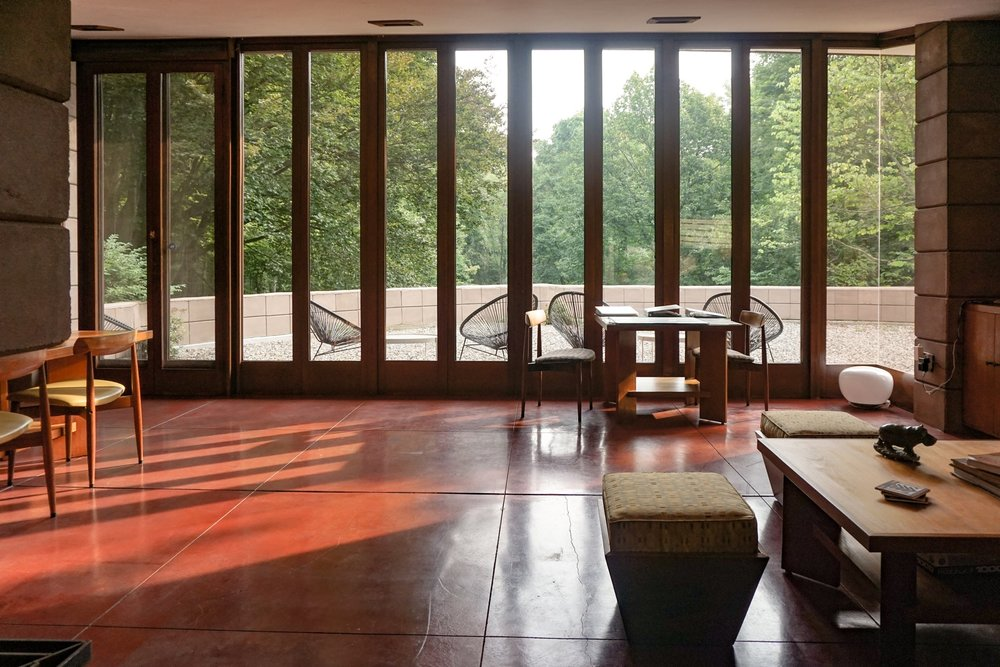 FLOOR TO CEILING WINDOWS WITH PATIO IN VIEW