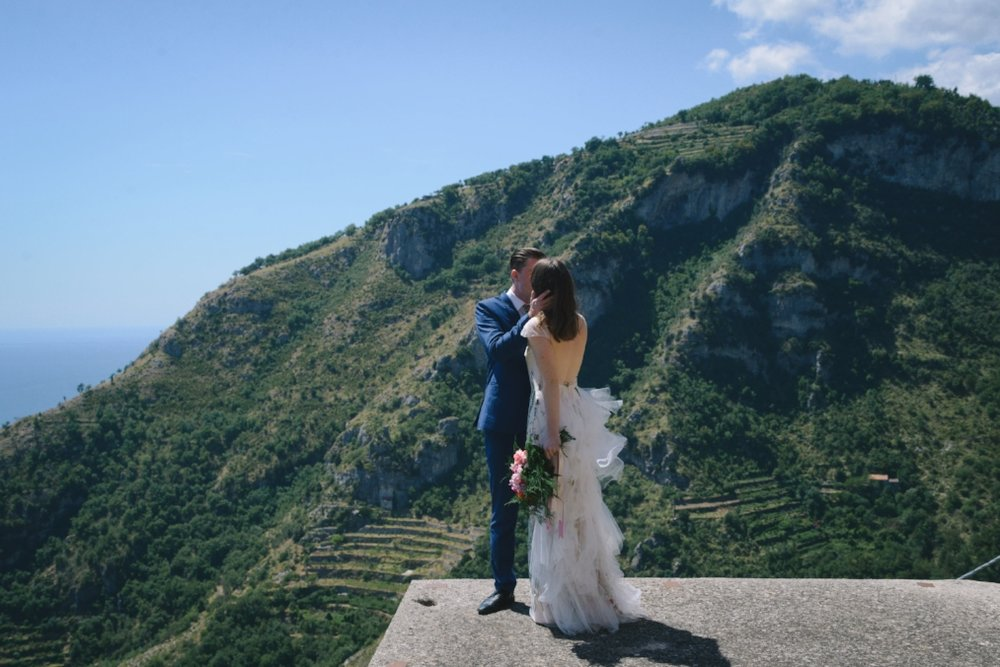 Well Travelled Bride Amalfi Elopement Kelsey Genna David Palfreyman Kiss.jpeg