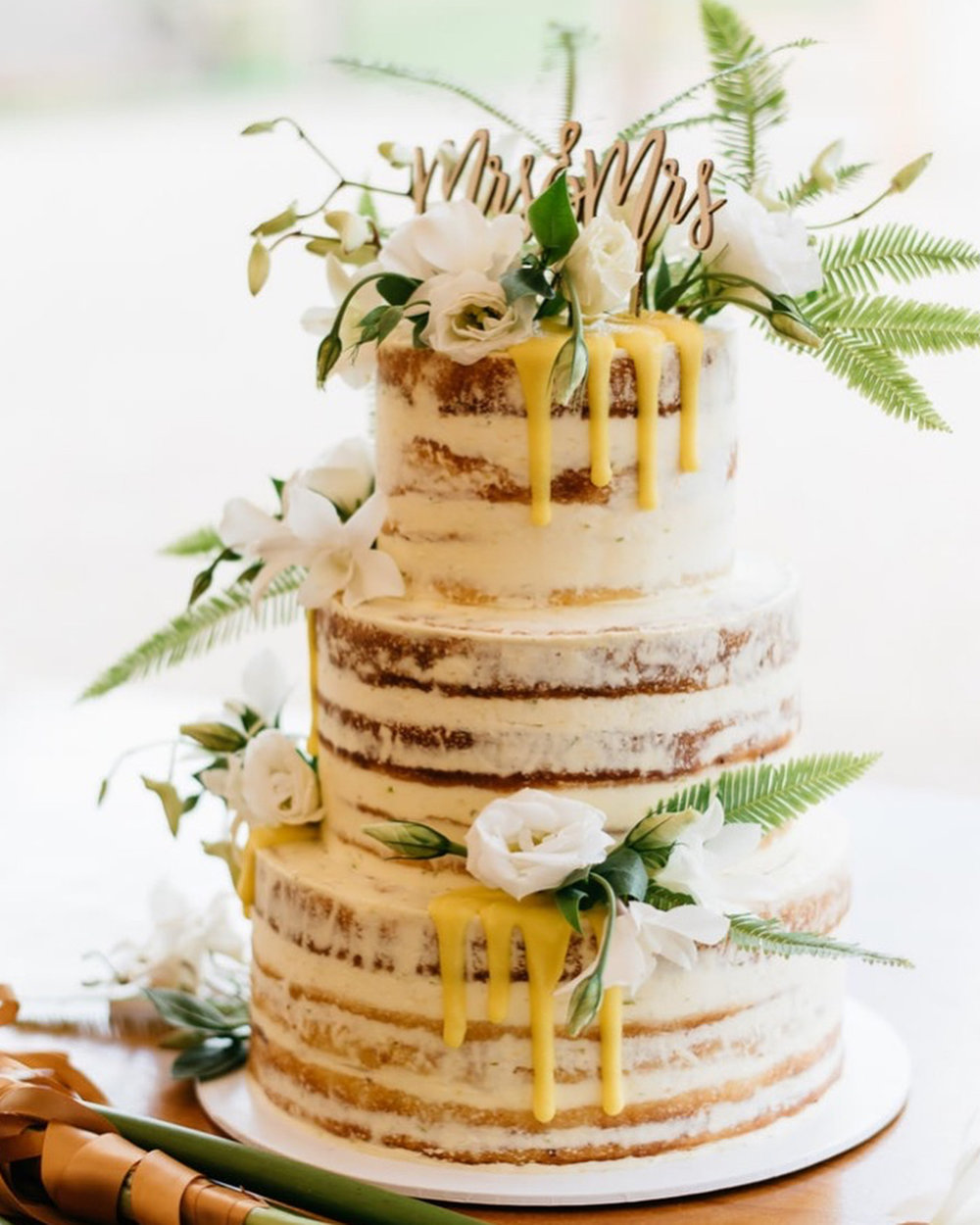 Unique, Colourful Cakes For Every Occasion - Your wedding is far from boring - shouldn't you say the same about your cake? Charlotte Wild of Let Them Eat Cake is Byron Bay's resident cake genius. Her designs are feminine, colourful, and take advantage of local blooms, berries, and sweet treats as unconventional but delicious toppers. Each cake is a work of art and cutting into them is a truly unforgettable experience. Gluten free and vegan options are also available, and Charlotte's team is willing to hand-deliver your confection to your Byron Bay venue, no matter the location!Visit WebsiteByron Bay, AustraliaPhone: +61 4 0367 7684Email: info@eatcake.net.au