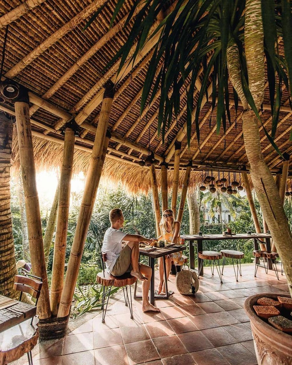Where Local and Luxury Meet - When in Bali, one expects the luxury of waking up in paradise, and that experience is exactly what Desa Visesa Ubud has to offer. This resort is one of the newer spots on the island, but it is the closest you will get to combining the authentic Balinese experience you crave with the five star luxuries and service a destination wedding requires.Desa Visesa Ubud is most certainly a luxury resort, but upon arriving you will get the sense that the grounds feel much more like a local Balinese village. The winding streets and lush plants of Ubus blend into the landscape of the resort and create a seamless connection of local culture and international luxury. Upon check in, you'll be greeted with a Balinese blessing and a performance from local musicians, who enliven the premises with their cheerful serenades. Before heading to your room, we highly recommend a brief golf cart tour around the property - there are so many hidden gems you wouldn't want to miss!The villas are incredibly private and are surrounded by vine-covered walls that overlook green Balinese rice fields. Each villa features an opened-aired lounge area looking onto your own private pool where you can start each morning with a relaxing soak in a gorgeous petal bath - a full-body pampering experience you certainly can't skip out on. The villa's entryways are decorated with Balinese symbols and traditional markings that bring good luck, alongside fragrant offerings to the gods - something found in every local's home and the reason why Bali always smells of burning incense! The bedrooms are, of course, airtight with strong air conditioning and the highest quality bedding. Our favorite aspect of our accommodations was the traditional bamboo ceilings that drew visiting geckos in the night… all part of the Balinese island experience!There are a variety of dining options on offer at Desa Visesa, including fine dining experiences with impressive river views to local warung vibes that r