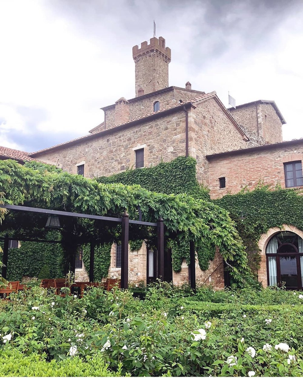 A Boutique Hotel Nestled Among Wine Country - Nestled in the hills of Montalcino, visitors will find not only one of Italy's finest wineries, but the rustic yet charming boutique Castello Banfi hotel. If exploring wine country is high on your list, these are the upscale accommodations you'll be needing. We highly recommend curling up with a book after a day trip to Sienna and soaking up the joys of this historic castle. Highlights of our stay included dinner and wine at the heavenly Sala dei Grappoli, adding to our knowledge of Italian wine with an exclusive Cellar Tour, sipping Aperol Spritz by the pool and spending a rainy afternoon in the incredibly stylish Reading Room. This spot is definitely a new #welltravelled favourite.Visit WebsiteMontalcino, Italy Phone: +39 057 787 7700Email: borgo@banfi.it