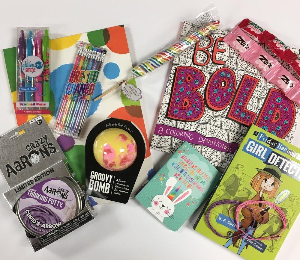 For girls: Glitter Smens ($5.50), Presto Chango Crayons ($7.50); Doodle Pad ($3.99); Unicorn Sucker ($2.50); Be Bold Coloring Devotional ($9.99); Zotz ($.50); Girl Detective Book ($7.99); Pura Vida Bracelets ($6.00 each); Mini Journal ($1.25); Groovy Bomb ($7.00); Thinking Putty ($15.00)