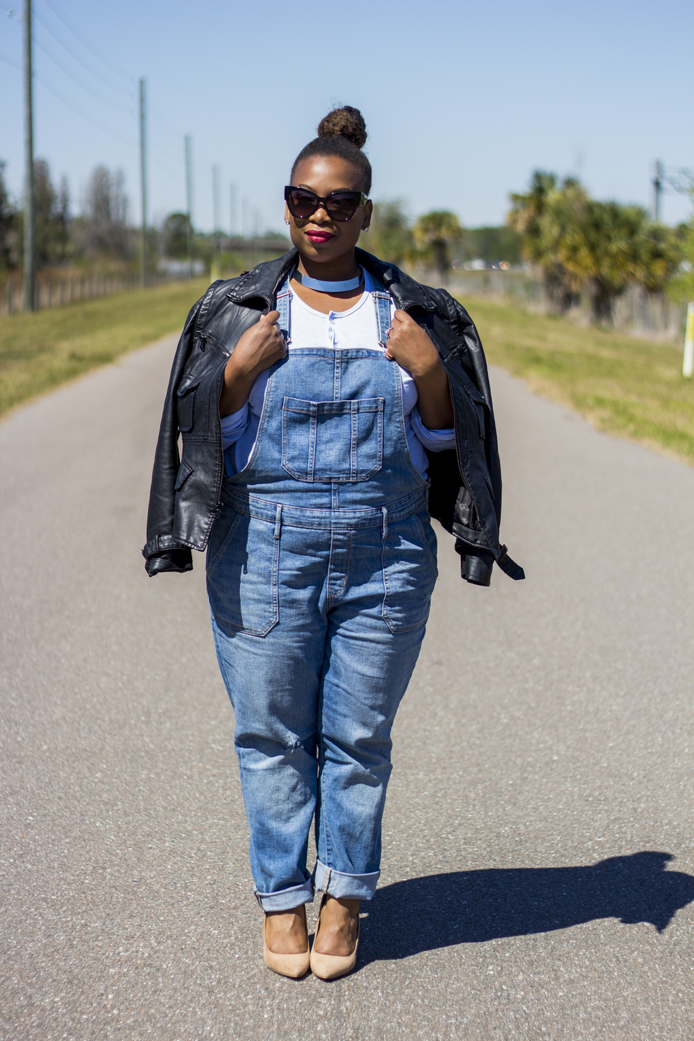 A leather jacket and collar necklace gives the overalls some edge!