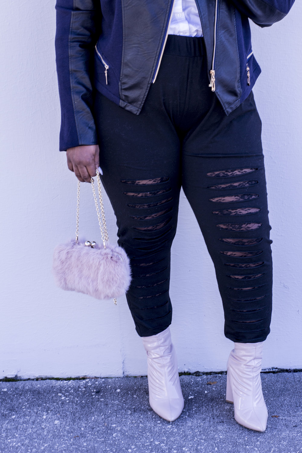 This pink chain faux fur cross body bag is so versatile. Get it  HERE ! These distressed leggings are out of the norm with the peek-a-boo lace under the distress. Get them  HERE !