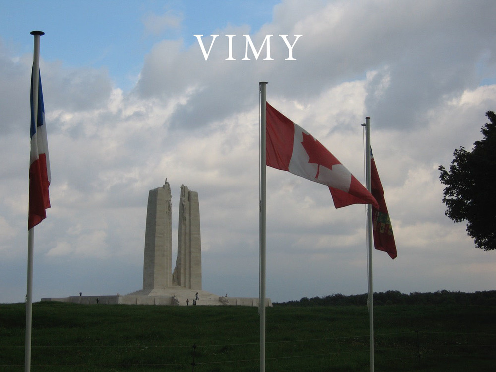 Vimy memorial with flags.jpeg