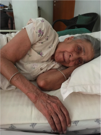 The deep wrinkled skin of the 90 year old bed ridden women that tell the story of her life-