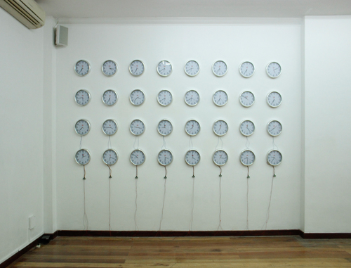 Drawing space with time , 2015 Interactive installation; 32 wall clocks, microcontrollers, sensors, 260 x 180 x 4 cm